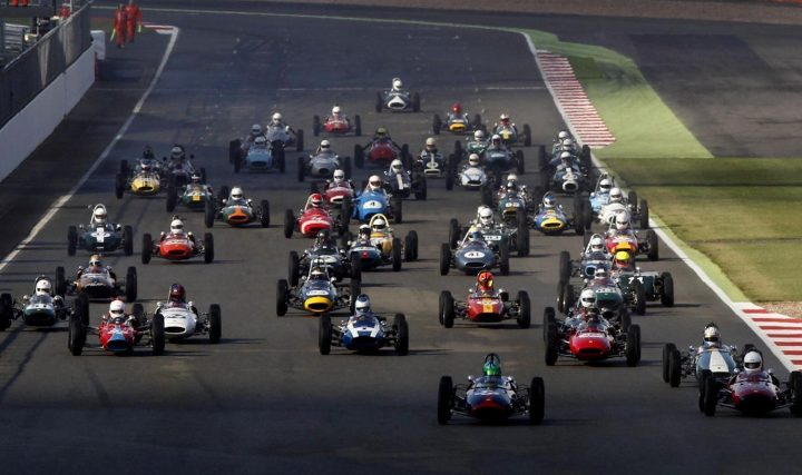 classic-race-cars-pictured-navigating-silverstone-race-course-and-each-other