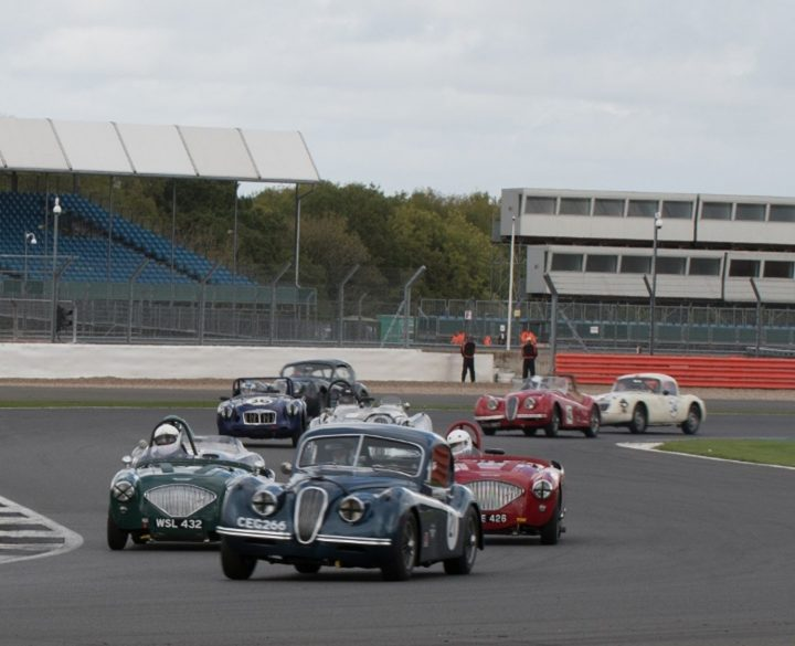 vaious-vintage-Aston-Martin-sports-cars-on-the-race-track-at-silverstone