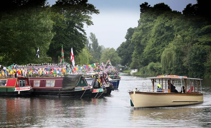 river-with-over-hanging-trees-and-canal-boats-moored-on-the-bank